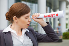 Businesswoman looks for money. Royalty Free Stock Photos