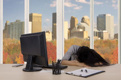 Businesswoman looks sleep deprivation in the office Stock Photography