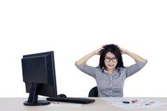 Businesswoman looks stress in the studio Royalty Free Stock Photos