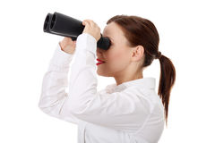Businesswoman looks threought binoculars Stock Images
