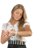 Businesswoman looks at the watch Stock Image
