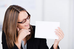 Businesswoman Looks At White Paper Royalty Free Stock Photography