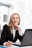 Businesswoman lost in thought Stock Photo