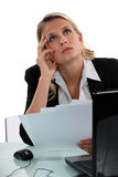 Businesswoman lost in thought Royalty Free Stock Images