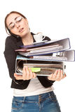 Businesswoman with a lot of folders calling Royalty Free Stock Photography
