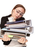 Businesswoman with a lot of folders and cup of coffee calling by Royalty Free Stock Photography