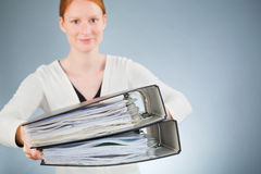 Businesswoman with a Lot of Paperwork Royalty Free Stock Photography