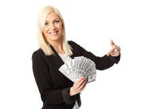 Businesswoman with lots of money Stock Photography