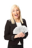 Businesswoman with lots of money Stock Photos