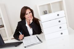 Businesswoman With Lots of Paperwork Royalty Free Stock Photography
