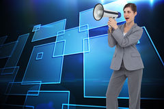Businesswoman with loudspeaker Stock Photography