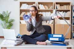 The businesswoman with loudspeaker in office. Businesswoman with loudspeaker in office Stock Image