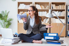 The businesswoman with loudspeaker in office. Businesswoman with loudspeaker in office Royalty Free Stock Images