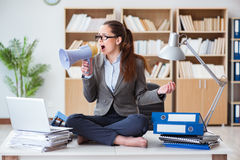 The businesswoman with loudspeaker in office. Businesswoman with loudspeaker in office Royalty Free Stock Photo