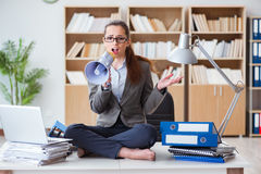 The businesswoman with loudspeaker in office. Businesswoman with loudspeaker in office Stock Photos