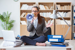 The businesswoman with loudspeaker in office. Businesswoman with loudspeaker in office Royalty Free Stock Image
