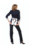 Businesswoman in lounge suit with question  mark b Stock Images