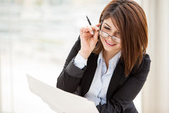 Businesswoman loving her job Stock Photo