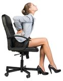 Businesswoman with lower back pain from sitting on royalty free stock photos