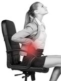Businesswoman with lower back pain, sitting on Royalty Free Stock Photos