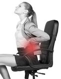 Businesswoman with lower back pain, sitting on Stock Images