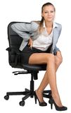 Businesswoman with lower back pain from sitting on Royalty Free Stock Photo