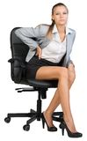 Businesswoman with lower back pain from sitting on Royalty Free Stock Image