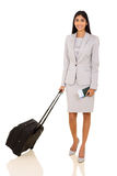 Businesswoman luggage bag. Portrait of businesswoman with luggage bag and air ticket on white background Royalty Free Stock Photos