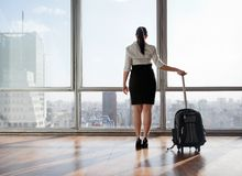 Businesswoman With Luggage Trolley Stock Images