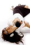 Businesswoman Lying Down Holding A Microphone Royalty Free Stock Photography