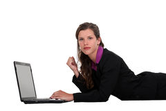 Businesswoman lying on the floor Stock Image