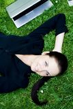 Businesswoman lying on grass Stock Photography
