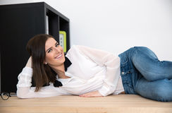 Businesswoman lying on the table in office Royalty Free Stock Image