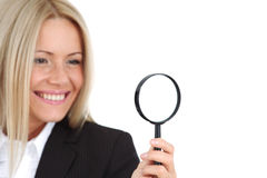 Businesswoman with magnifier Royalty Free Stock Images