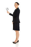 Businesswoman with magnifier glass. Stock Photos