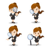 Businesswoman with magnify glass Stock Photography