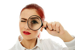Businesswoman with magnifying glass Stock Images