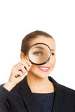 Businesswoman with magnifying glass. Royalty Free Stock Image