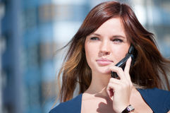 Businesswoman make call by mobile phone. Royalty Free Stock Photography