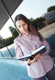 Businesswoman make notes in organizer while standing against off Stock Photography