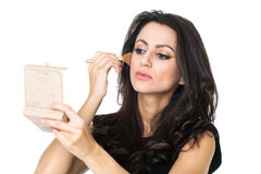 Businesswoman with a make-up mirror Stock Photos