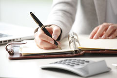 Free Businesswoman Makes A Note In Notebook. Royalty Free Stock Photos - 38142998