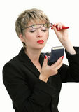 Businesswoman makeup. Businesswoman checking her makeup Royalty Free Stock Photography