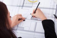 Businesswoman Making Blueprint Stock Photo