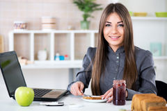 Businesswoman making breakfast Stock Image