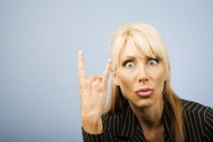 Businesswoman making bull horns Royalty Free Stock Photo