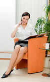 Businesswoman making call Stock Photo