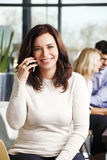 Businesswoman making call Stock Images