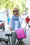 Businesswoman making call while walking in the city Royalty Free Stock Images