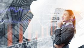 Businesswoman making desicion. Pensive businesswoman with hand on chin modern buildings and infographs Stock Photos